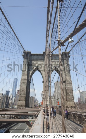 NEW YORK - May 30, 2015: People ejoying a walk along Brooklyn Bridge in New York city.