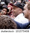 NEW YORK - MAY 1: Rage Against The Machine guitarist Tom Morello speaks to the media about the Occupy Guitarmy effort during May Day protests in Bryant Park on May 1, 2012 in New York, NY. - stock photo