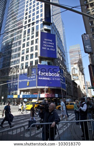 NEW YORK - MAY 18: Sign announcing Facebook IPO is flashed on a screen outside the Thomson Reuters building at the opening bell in Times Square on May 18, 2012 in New York City. - stock photo