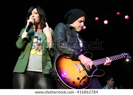 NEW YORK-MAY 6: Singers Shawna Thompson (L) and Keifer Thompson of Thompson Square perform onstage at the Paramount on May 6, 2016 in Huntington, New York. - stock photo