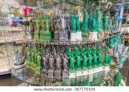 NEW YORK - MAY 05: Statue of Liberty souvenirs at a store window in New York on May 5, 2015 in New York,NY. The Statue of Liberty is a symbol of USA. It was a gift from France to the United States. - stock photo
