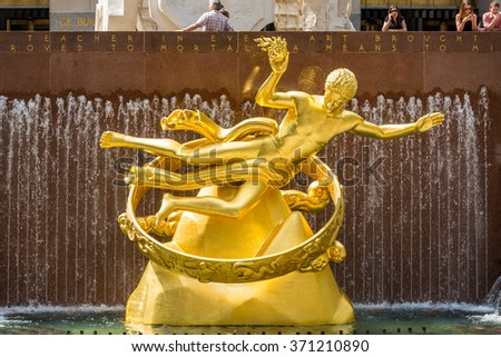 NEW YORK - MAY 05: Statue of Prometheus above the ice rink at the Rockefeller Center on MAy 5, 2015 in Manhattan, New York. Rockefeller Center was declared a National Historic Landmark in 1987. - stock photo