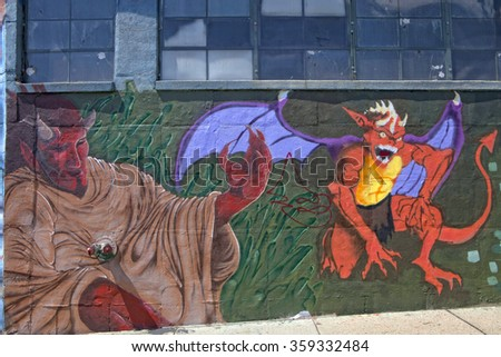 NEW YORK - May 31, 2011: Street art mural painted on a wall  a neighborhood in Queens.