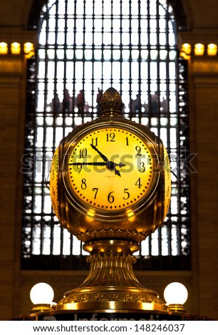 NEW YORK, May 7th, 2013. Clock over the information booth in the middle of the great hall in Grand Central Terminal - New York on May 7. Grand Central Station is the world famous spot in New York City
