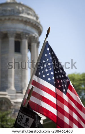 NEW YORK - MAY 25 2015: The American Flag and Wounded Warrior Project Flag in front of the Soldiers and Sailors Monument in Riverside Park after the Memorial Day Observance during Fleet Week NY 2015. - stock photo