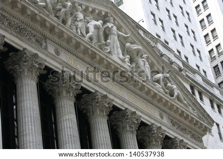 NEW YORK - MAY 30: The New York Stock Exchange facade is shown on May 30, 2013 in New York City. The Exchange building was built in 1903. - stock photo
