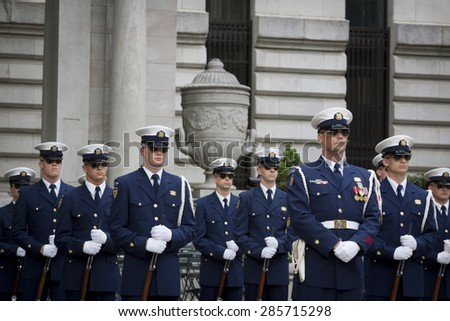 NEW YORK - MAY 21 2015: The US Coast Guard Ceremonial Honor Guard Silent Drill Team perform next to the New York Public Library in Bryant Park during Fleet Week NY 2015. - stock photo