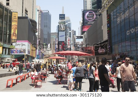 NEW YORK - May 29, 2015: Times Square busy with people and tourists. More than 300 thousand people visit this square every day.