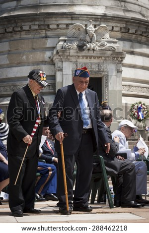 NEW YORK - MAY 25 2015: Two US veteran make their way to the stone steps of the Soldiers and Sailors Monument after the Memorial Day Observance service held in Manhattan during Fleet Week NY 2015. - stock photo
