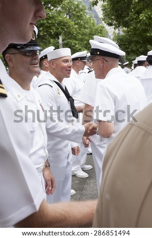 NEW YORK - MAY 22 2015: US Navy sailors line up to be congratulated after the promotion ceremony at the National September 11 Memorial site during Fleet Week 2015. - stock photo