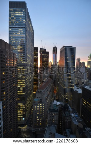 NEW YORK, NEW YORK - AUGUST 7, 2012: Twilight as the sun sets over Lower Manhattan. Famous New York landmarks with the Hudson and New Jersey in the distance. - stock photo
