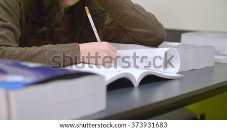 New York, New York - January 26, 2016: A student preps for the New SAT at a Kaplan Test Prep center. Those hoping to attend US colleges will take a new version of the standardized test in March 2016.
