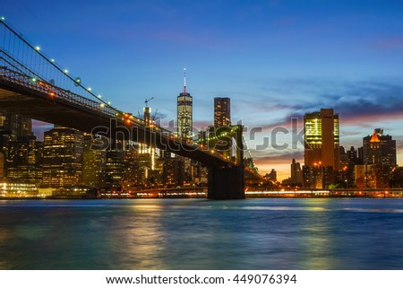 New York, New York - 1 July 2016: Brooklyn Bridge in New York City over looking the Manhattan skyline during sunset.