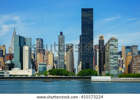 New York, New York - 15 July 2016: Gantry Plaza State Park in Long Island City overlooking the Trump World Tower and the Manhattan Skyline in New York City.