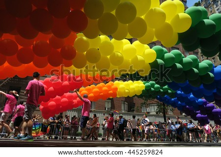 NEW YORK, NEW YORK - JULY 26, 2016: Rainbow colored balloons in the Gay Pride Parade on 5th avenue. The colors are the symbol of LGBT pride and diversity. Editorial use only.  - stock photo