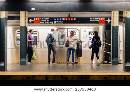 NEW YORK, NEW YORK - JUNE 28, 2013: MTA subway train station platform with people traveling in New York on June 28, 2013. The NYC subway system is one of the oldest in the USA. - stock photo