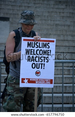New York, New York. - June 10, 2017: People carrying signs supporting Islam at a counter protest to an anti Sharia rally in Manhattan in 2017.