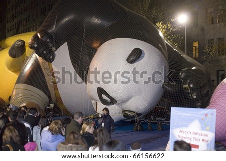 NEW YORK, NEW YORK - NOVEMBER 24: Giant Panda balloon gets inflated the night before the Macy's Thanksgiving parade.  Taken November 24, 2010 in New York City. - stock photo
