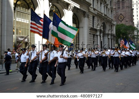 New York, New York. - September 9, 2016: Members of the NYPD Emerald Society marching in a procession marking the anniversary of the 9/11 terrorist attacks in Lower Manhattan in 2016 in New York City.