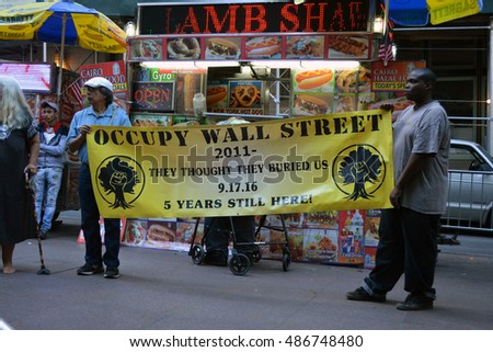 New York, New York. - September 17, 2016: People gathered at Zuccotti Park in Lower Manhattan to mark the fifth anniversary of the Occupy Wall Street movement in 2016 in New York City
