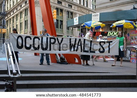New York, New York. - September 17, 2016: People gathered in Zuccotti Park in Lower Manhattan to mark the fifth anniversary of the start of the Occupy Wall Street movement  in 2016 in New York City.