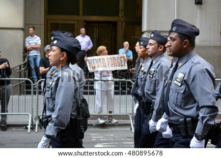 New York, New York. - September 9, 2016: Police Officers marching in a procession marking the anniversary of the 9/11 terrorist attacks in Lower Manhattan in 2016 in New York City.