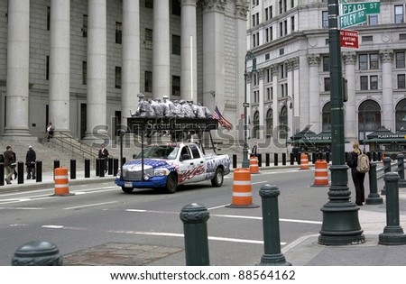 NEW YORK, NEW YORK - SEPTEMBER 12: Sculptor Sergio Furnari's truck in front of United States District Court with sculptures representing working immigrants. September 12, 2006 in NYC.