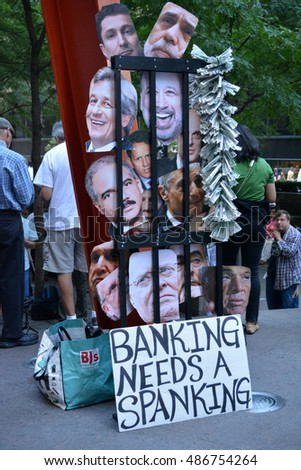 New York, New York. - September 17, 2016: Sign made by people gathered at Zuccotti Park in Lower Manhattan to mark the fifth anniversary of the Occupy Wall Street movement in 2016 in New York City