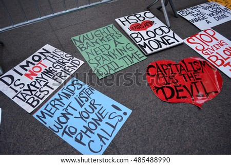 New York, New York. - September 17, 2016: Signs left by people gathered at Zuccotti Park in Lower Manhattan to mark the fifth anniversary of the Occupy Wall Street movement in 2016 in New York City