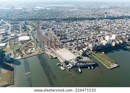 NEW YORK, NEW YORK - SEPTEMBER 27, 2014: Stunning aerial view of Hoboken, New Jersey, including the PATH station and the railyards from a helicopter. - stock photo