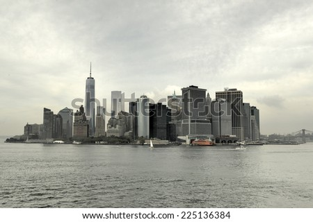 NEW YORK, NEW YORK - SEPTEMBER 21, 2014: View of Downtown Manhattan, New York from the East River on a fall cloudy day. - stock photo