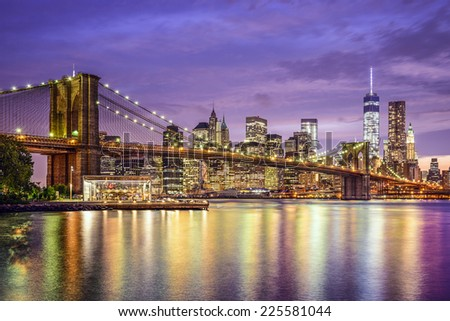New York, New York, USA city skyline with the Brooklyn Bridge and Manhattan Financial District over the East River. - stock photo