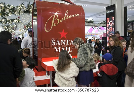 NEW YORK, NEW YORK, USA - DECEMBER 10: Children write letters to Santa inside Macy's department store in Herald Square and 34th street.  Taken December 10, 2015 in NY.