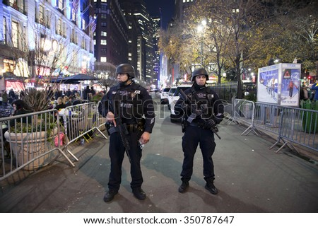NEW YORK, NEW YORK, USA - DECEMBER 10: Members of the NYPD Police Strategic Response Group stand guard at Christmas time in Herald Square and 34th street.  Taken December 10, 2015 in NY.