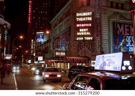 New York, New York, USA - June 2, 2011: West 44th street off of Times Square in the evening. Taxi Cabs and pedestrians pass by the Majestic, Broadhurst, Helen Hayes and Shubert Broadway theatres. - stock photo