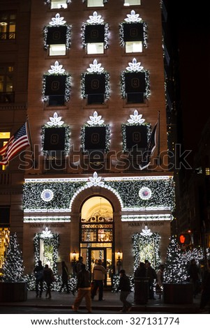 New York, New York, USA - November 28, 2012: The exclusive Harry Winston Jewelers on 5th Avenue in Manhattan. This shot was taken in the evening during the 2012 Christmas Holiday season. - stock photo