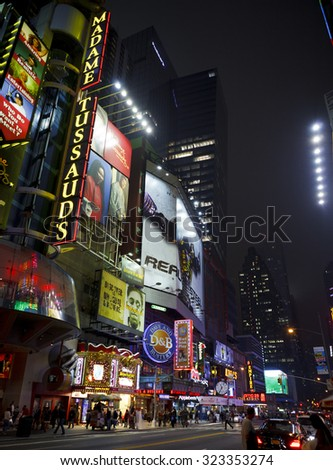 New York, New York, USA - October 13, 2011: The bright lights of 42nd street at night. 42nd street between 7th and 8th Avenues is full of entertainment options. - stock photo
