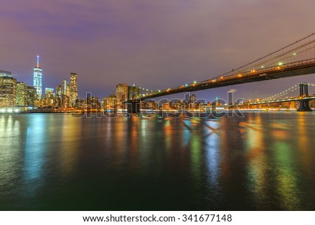 NEW YORK - NOV 01: Cityscape of Manhattan and Brooklyn bridge at twilight on Nov 01, 2015. New York City is the most densely populated city in the United States.