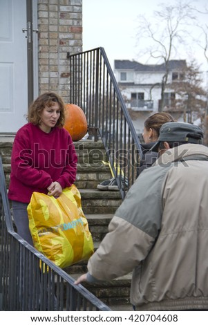 NEW YORK -NOV 12:Destroyed homes during Hurricane Sandy in the flooded neighborhood at South Beach Staten Island area on November 10, 2012 in New York City, NY. Volunteers delivering clothes - stock photo