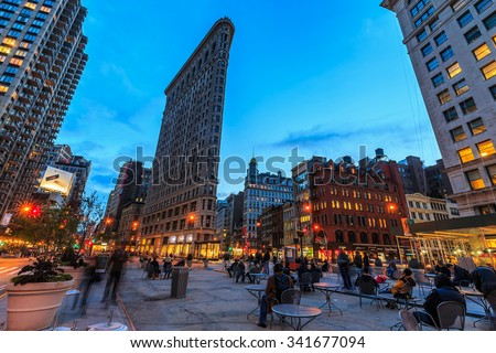 NEW YORK - NOV 02: Flatiron Building at twilight on Nov 02, 2015. It's a triangular 22-story steel-framed landmarked building located at 175 Fifth Avenue, Manhattan, New York City.