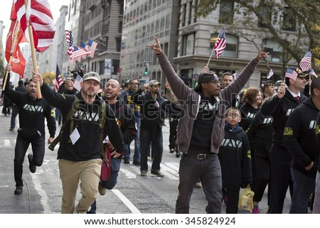 NEW YORK - NOV 25 2015: Members of Iran and Afghanistan Veterans of America (IAVA) holding American Flags during the annual Americas Parade up 5th Avenue on Veterans Day in Manhattan.