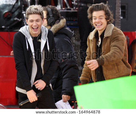 NEW YORK - NOV 26: Niall Horan and Harry Styles of One Direction perform on 'Good Morning America' in Central Park on November 26, 2013 in New York City. - stock photo