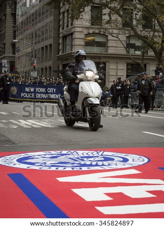 NEW YORK - NOV 25 2015: One of the members of the New York City Police Department on motocycle leads the NYPD group across the red carpet  in the annual Americas Parade up 5th Avenue on Veterans Day.