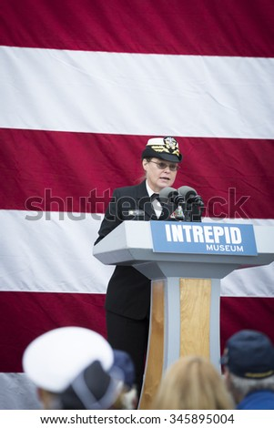 NEW YORK - NOV 25 2015: Rear Admiral Cynthia M. Thebaud, Commander, Expeditionary Strike Group 2 speaks to the audience at the Intrepid Sea, Air & Space Museum wreath laying ceremony on Veterans Day. - stock photo