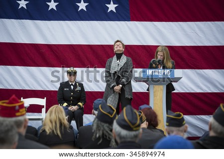 NEW YORK - NOV 25 2015: Susan Marenoff-Zausner, Pres. Intrepid Sea, Air, & Space Museum introduces Army vet Loree Sutton, Commissioner NYC Mayors Off. of Veterans Affairs at the event on Veterans Day. - stock photo