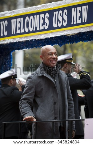 NEW YORK - NOV 25 2015: Television personality and former USMC Lt Commander Montel Williams smiles to the crowd from the USS New York float during the Americas Parade up 5th Avenue on Veterans Day. - stock photo