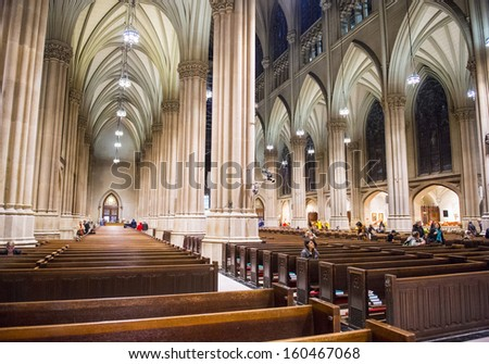 NEW YORK - NOV 01 : The interior of St. Patrick's Cathedral, a neogothic Roman Catholic Cathedral in New York City on November 01 2012 , the cathedral can accommodate 2,200 people. - stock photo