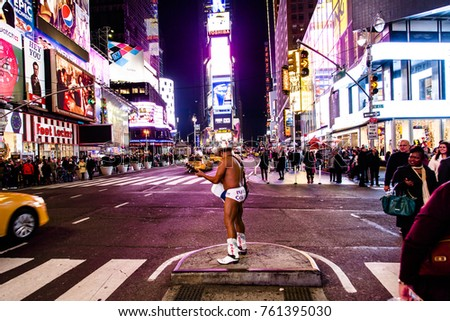 "NEW YORK - NOV 11: The ""Naked Cowboy"" street performer in Times Square, New-York, USA on November 11, 2012."