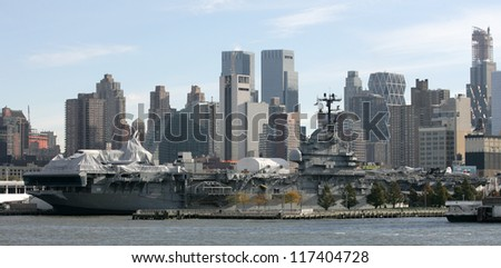 NEW YORK - NOV 1: The Space Shuttle Enterprise lays on the USS Intrepid on November 1, 2012 in New York City. Foam from the tail fin is reportedly missing after Hurricane Sandy hit the area on October 29, 2012. - stock photo