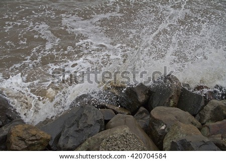 NEW YORK -NOV 12:Tide and waves hitting the rocks after Hurricane Sandy in the flooded neighborhood at South Beach Staten Island area on November 1, 2012 in New York City, NY.  - stock photo